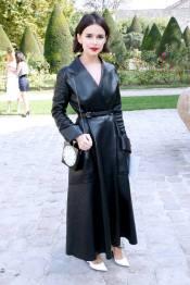 Miroslava-Duma-wears-a-black-double-face-leather-'Doris-1947'-coat-and-Dior-accessories.